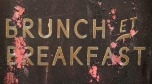 A Grungy French Brunch And Breakfast Sign Outside A Restaurant