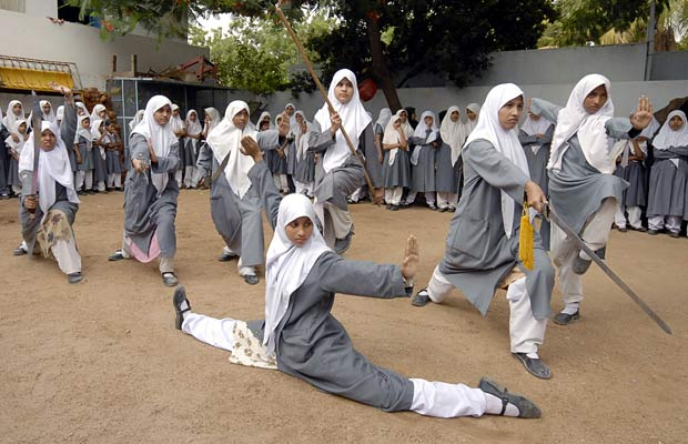 A group of Indian Muslim girls at a school in Hyderabad training in the martial art of Wushu, a type of Kung Fu