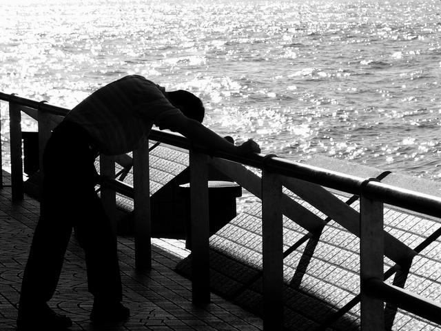 depressed man at waterside