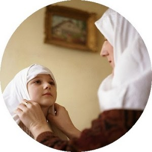 mother-adjusts-daughters-hijab