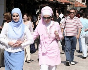 Two Bosnian Muslim women walking in Sarajevo.