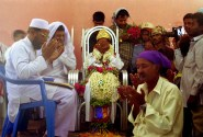 Men and the groom pray in a colorful muslim wedding in south Karnataka, India.