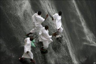 Muslim Hajj pilgrims seek cover following heavy rains