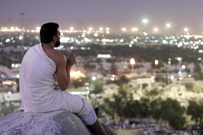A Hajji prays at Mount Arafat duriing Hajj