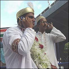 Bohra Muslims are renowned as traders and businessmen - grooms were making business calls minutes before they married.