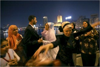 Newlyweds celebrated their marriage as friends and relatives danced on a bridge over the Nile in Cairo.