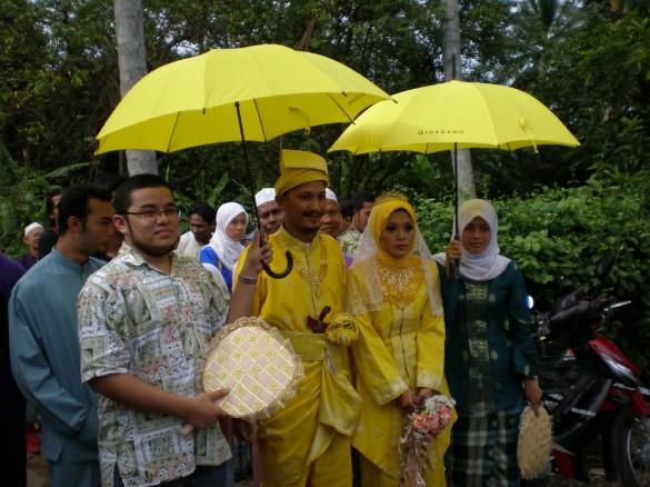 Best man, groom, bride and bridesmaid at a Malaysian Muslim wedding