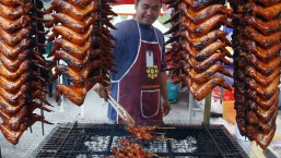 This picture taken September 5, 2008 shows a stall worker preparing roasted chicken wings to be sold at a Ramadan bazaar in downtown Kuala Lumpur for the breaking of their fast. In Muslim households across Asia, the inflation crisis is casting a shadow over the holy month of Ramadan, and making the nightly ritual of breaking the fast a more meagre affair. From Afghanistan to Malaysia, the high prices of food are forcing the poor to go without, and curtailing the lavish evening buffets which the well-off have flocked to in better economic times. (KAMARUL AKHIR/AFP/Getty Images) #