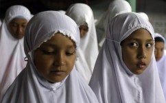 Thai Muslim girls pray during Ramadan