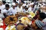 Dhaka, Bangladesh: The fast is broken at a market on the first day of Ramadan.