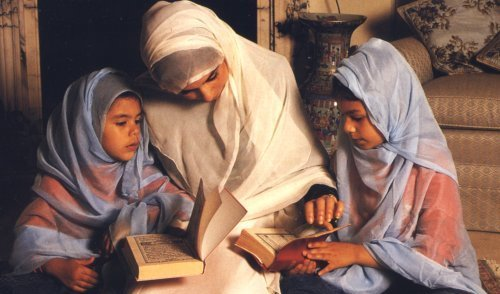 Muslim mother reads Quran with her daughters