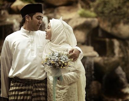 A happy Malaysian Muslim couple
