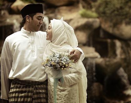 A happy Malaysian Muslim couple