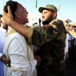 Men hug during Eid in Tripoli, Libya, after the 2011 uprising against Qaddafi