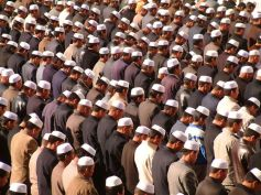 Chinese Muslims stand in prayer in Ramadan.