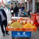A Muslim vendor in East Turkestan, China.