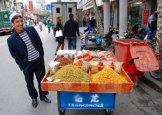 A Muslim vendor in East Turkestan, China.