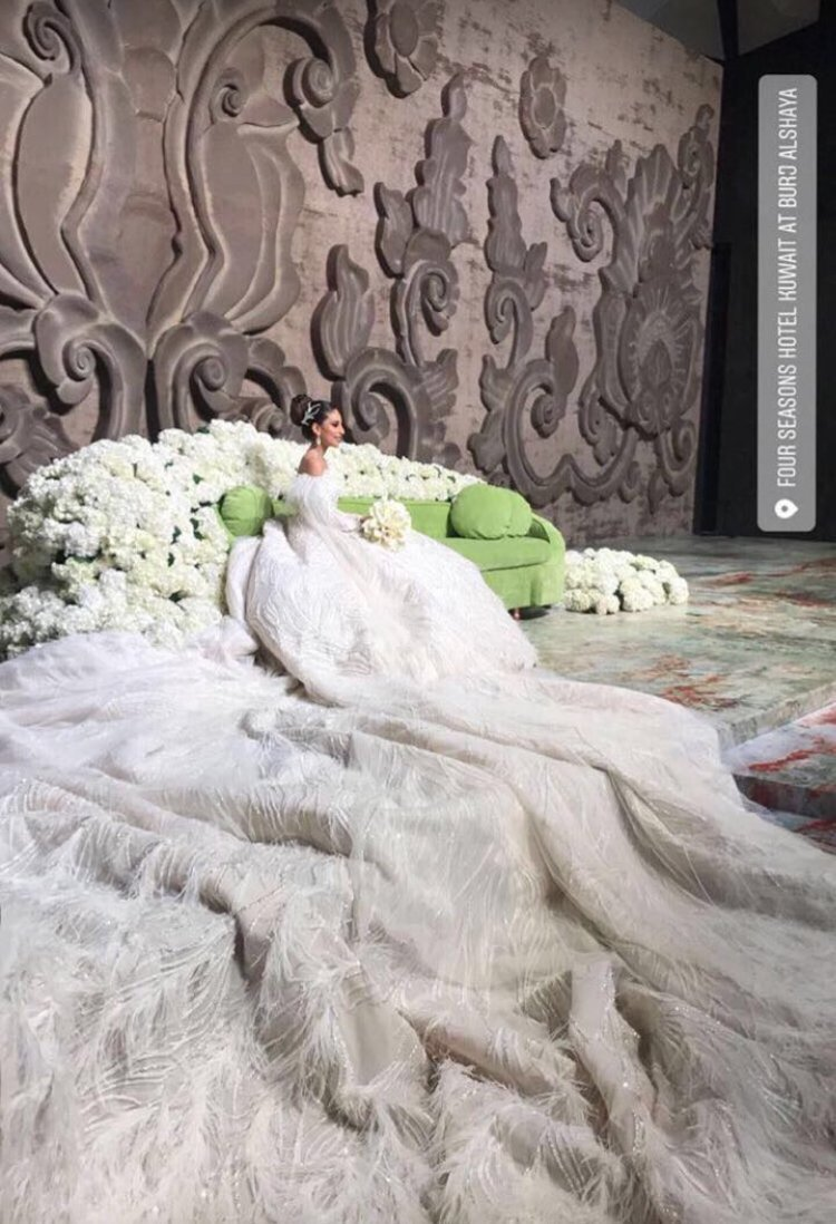 Bride in immense wedding gown