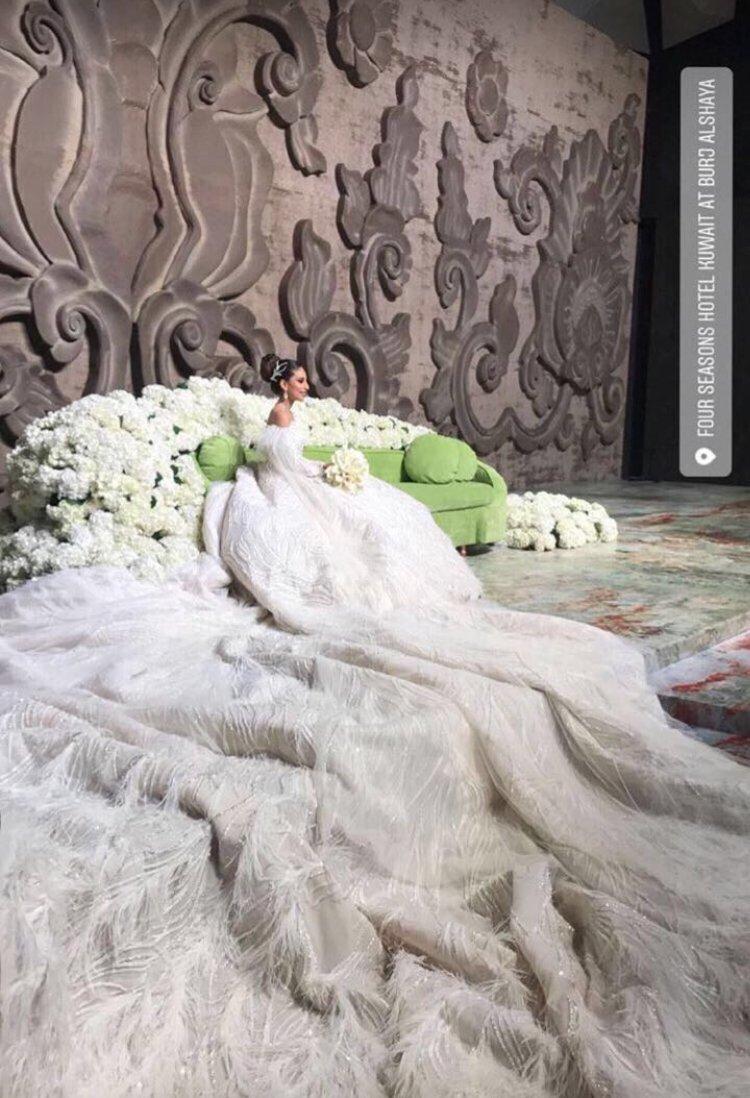 Bride in immense wedding gown