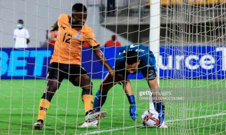 Moses Phiri gestures to the ball against Anas Zniti