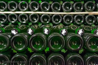 Rows of bottles aging at Cantillon