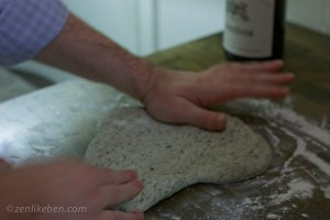Kneading the pizza dough for our Sriacha Pizza!