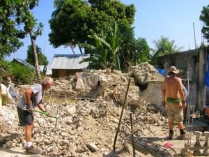 Volunteers removing rubble in Haiti