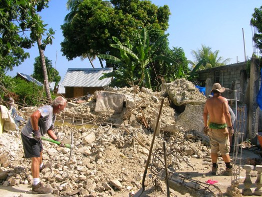 Volunteers removing rubble in Haiti