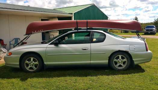 Car with Canoe ready to go to Maligne Lake