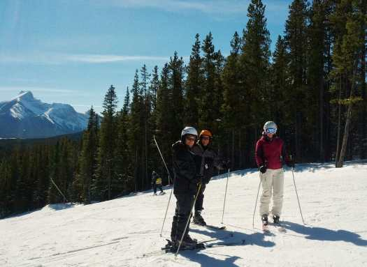 Thea teaching her family to ski at Nakiska