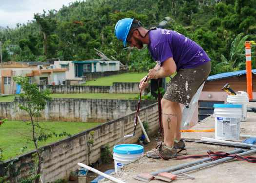 Lifting sealant onto the roof in Puerto Rico