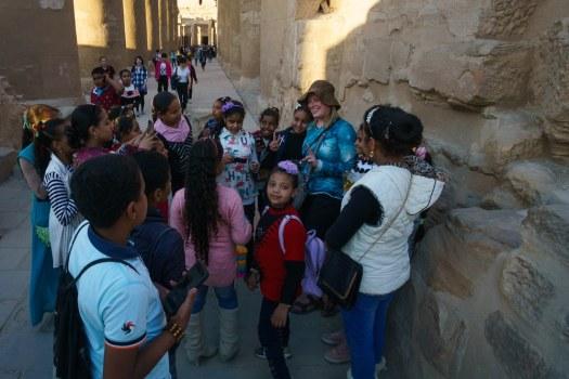 Kids surrounding Thea in Egypt
