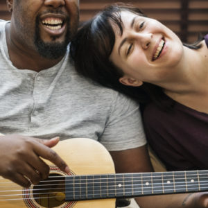 couple-playing-and-singing-together-6MZ97JB