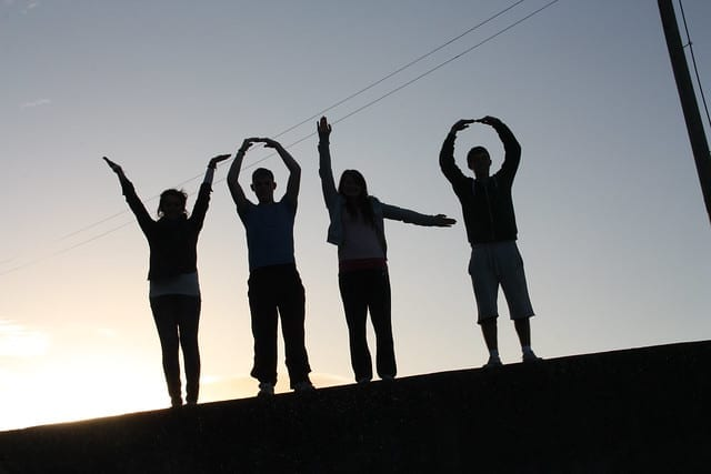 YOLO formation by people's hands