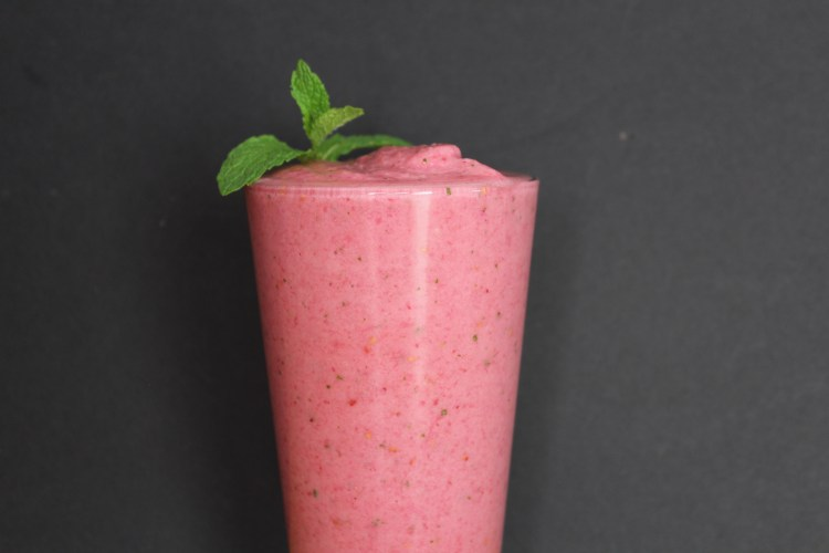 Raspberry Pineapple Mint Smoothie - This delicious raspberry, pineapple and mint smoothie is perfect for a quick breakfast or snack! Each nutritious sip is the perfect balance of sweet and tangy with a hint of refreshing mint!