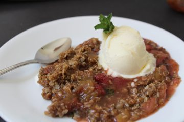 Strawberry Rhubarb Mint Crisp - a summer classic with a twist! This easy dessert can be prepped in minutes, and paired with a scoop of ice cream is a delicious end to a meal.