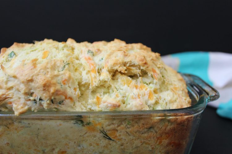 Savory Herb and Cheddar Squash Bread - this is the perfect way to use up all that summer squash! With cheddar, garlic, green onions and dill mixed into the batter this loaf is hard one to resist.
