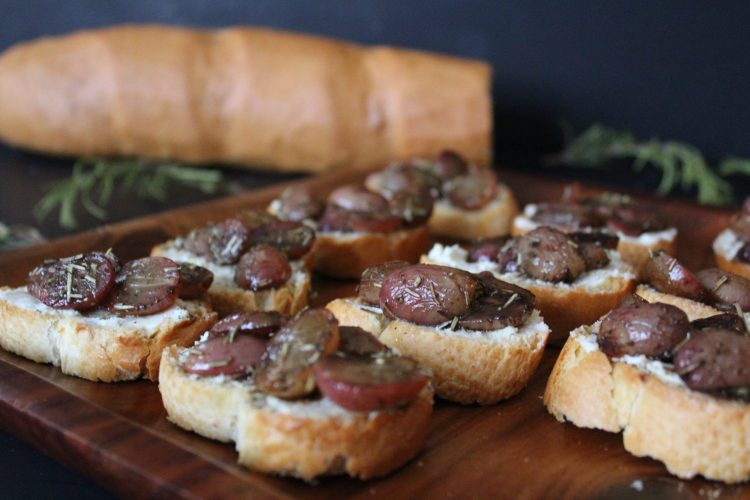 Roasted Grape & Goat Cheese Crostini - balsamic roasted grapes paired with creamy herbed goat cheese and honey make for a beautiful winter party appetizer! These elegant bites pack a ton of flavour, are simple to pull together and pair wonderfully with a glass of your favourite wine.