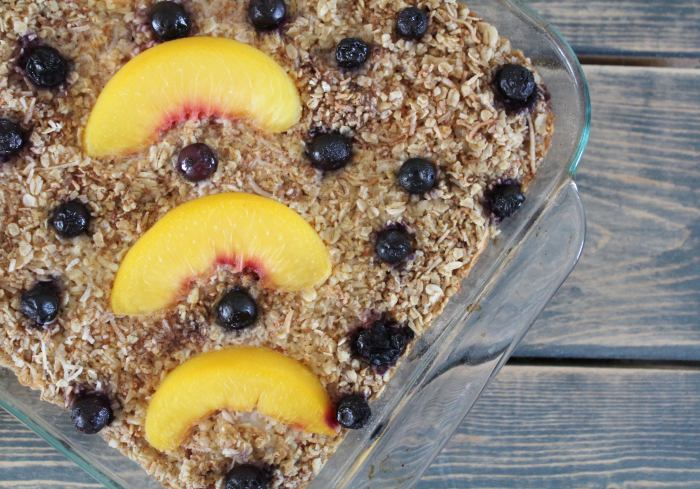 Blueberry Peach Coconut Baked Oatmeal - this delicious baked oatmeal is an easy make-ahead breakfast, perfect for busy mornings. You can bake it in advance and then reheat servings as needed. The blueberries, peaches and coconut give a lovely freshness to this comforting healthy breakfast!