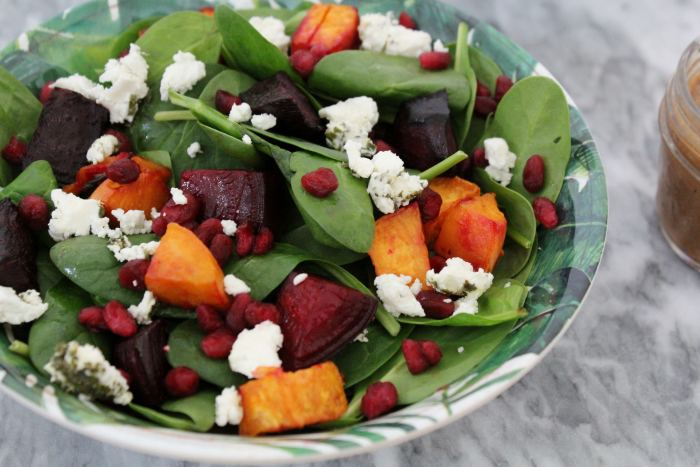 A bowl of Beet, Sweet Potato and Goat Cheese Salad with Citrus Balsamic Vinaigrette.