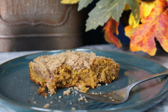 Pumpkin Spice Coffee Cake - a deliciously spiced coffee cake recipe with a cinnamon streusel topping. With sour cream and pumpkin puree it is moist, slightly dense and perfect for fall. Pair it with a cup of fresh coffee for a heavenly breakfast.