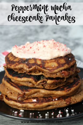 Peppermint Mocha Cheesecake Pancakes - decadent and festive, these pancakes are the perfect breakfast for your holiday mornings! Fluffy mocha pancakes topped with candy cane cheesecake frosting are sure to satisfy any sweet tooth and bring on the holiday cheer.