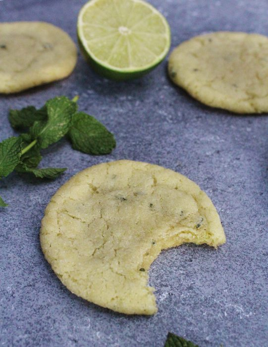 Mojito Sugar Cookies - the classic cocktail in cookie form! Made with fresh mint, lime zest and rum, these sugar cookies are perfectly soft and chewy, with a delicious taste of the tropics.