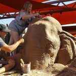 Sand Sculpture of Elephant Playing Chess with a Mouse