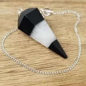 Pendulums are a form of Divination. They help those seeking information to focus the energy so the messages from the divine are clear. Think of it like a receiver for spirit. The energy you can't see is transmitted through the pendulum helping to give a clear concise signal. This pendulum is all about balance. It helps to align the chakras with Black Tourmaline for the Root Chakra and White Agate for the Crown Chakra at the top of your head.