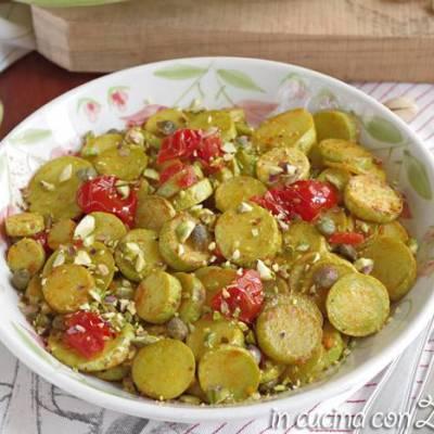 zucchine in padella pomodori e pistacchi