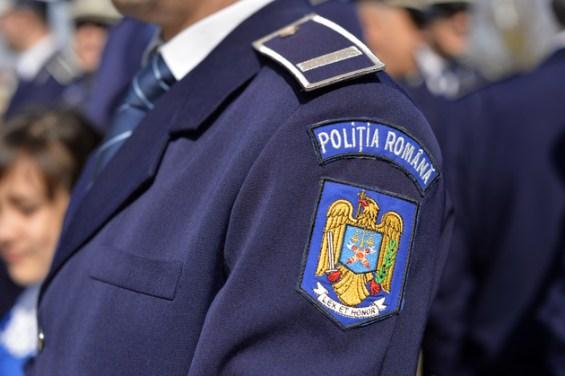 Un politist participa la evenimentul prilejuit de Ziua Politiei Romane, in orasul Racari, judetul Dambovita, miercuri, 25 martie 2015. OCTAV GANEA / MEDIAFAX FOTO