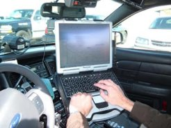 laptop in a patrol car - Chemung County Police Cars Get Connected: Area Police to Use Wireless Broadband