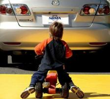 Child in driveway - Dangerous Driveway Accidents Pose a Big Risk to Small Children