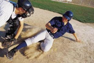 Baseball sliding into base - NY Accident Lawyer Explains Why He Probably WON'T Take Your School Sports Injury Case
